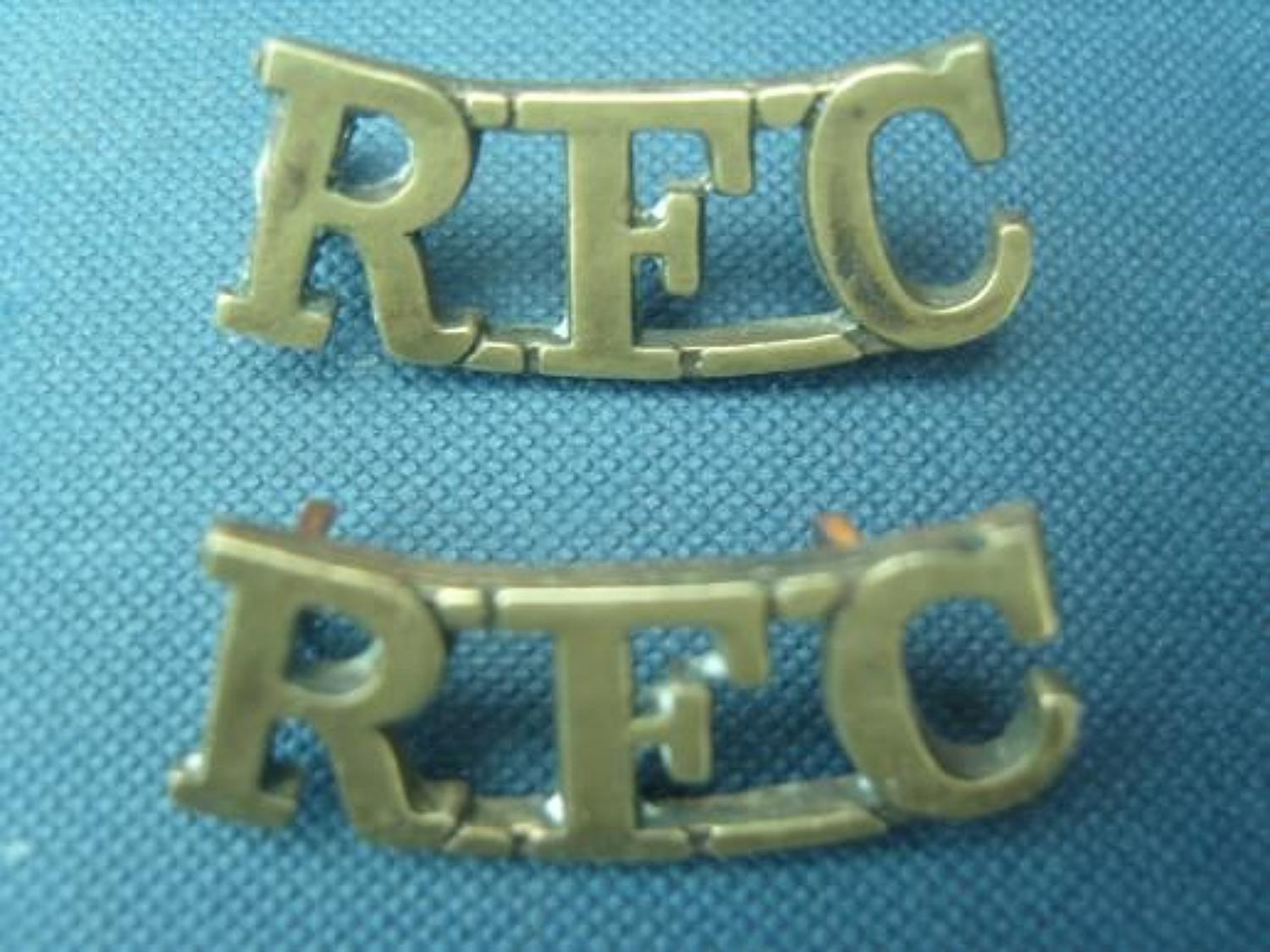 WW1 RFC (Royal Flying Corps) brass shoulder title pair.