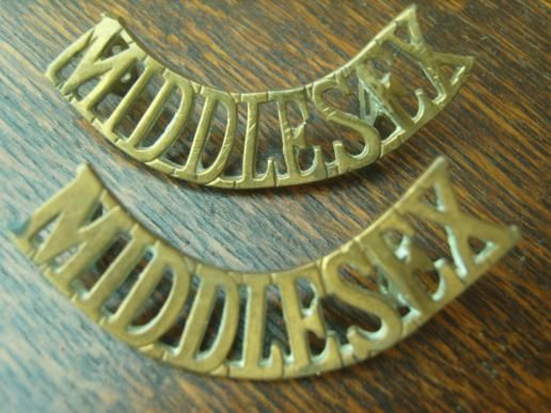 Pair of WW1 Brass shoulder titles. Middlesex Regiment
