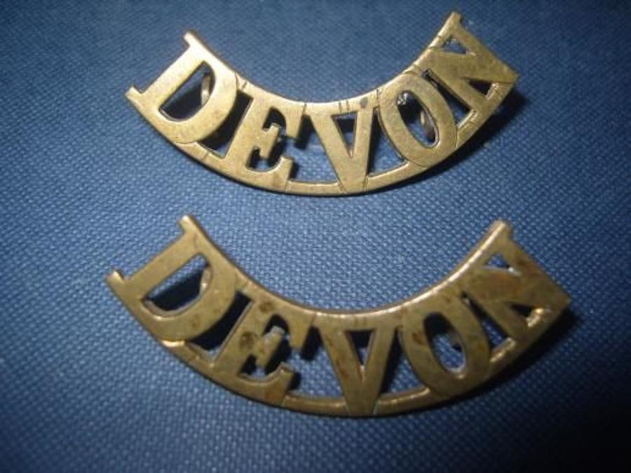 Pair of WW1 Brass shoulder titles. Devonshire Regiment