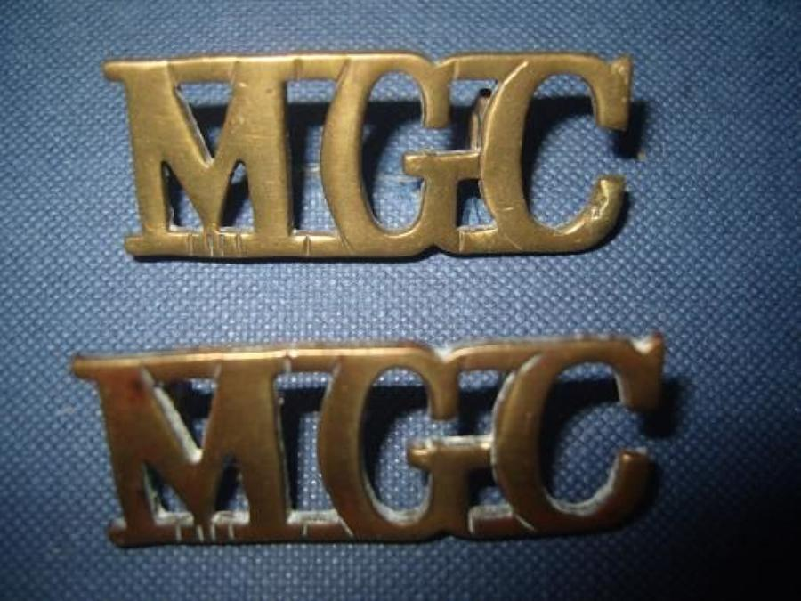 Pair of WW1 Brass shoulder titles. Machine Gun Corps