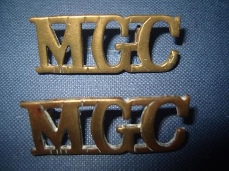 Pair of WW1 Brass shoulder titles. Machine Gun Corps