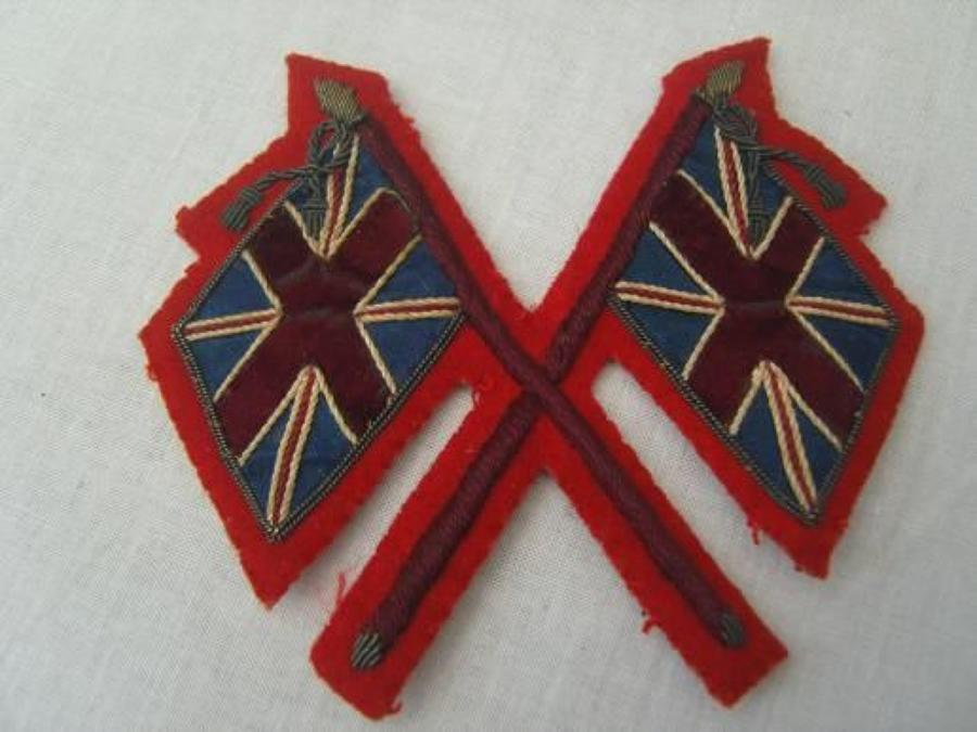 Pre WW1 crossed flags recruiting sergeants arm badge.