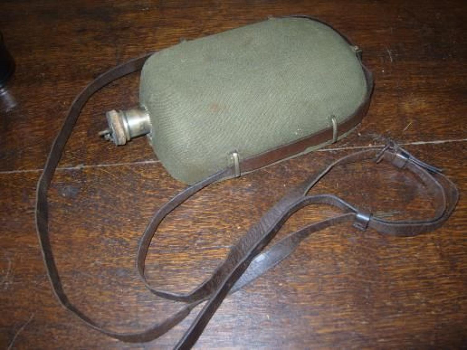 WW1 British Officers Water Bottle. Khaki cover & leather strap.