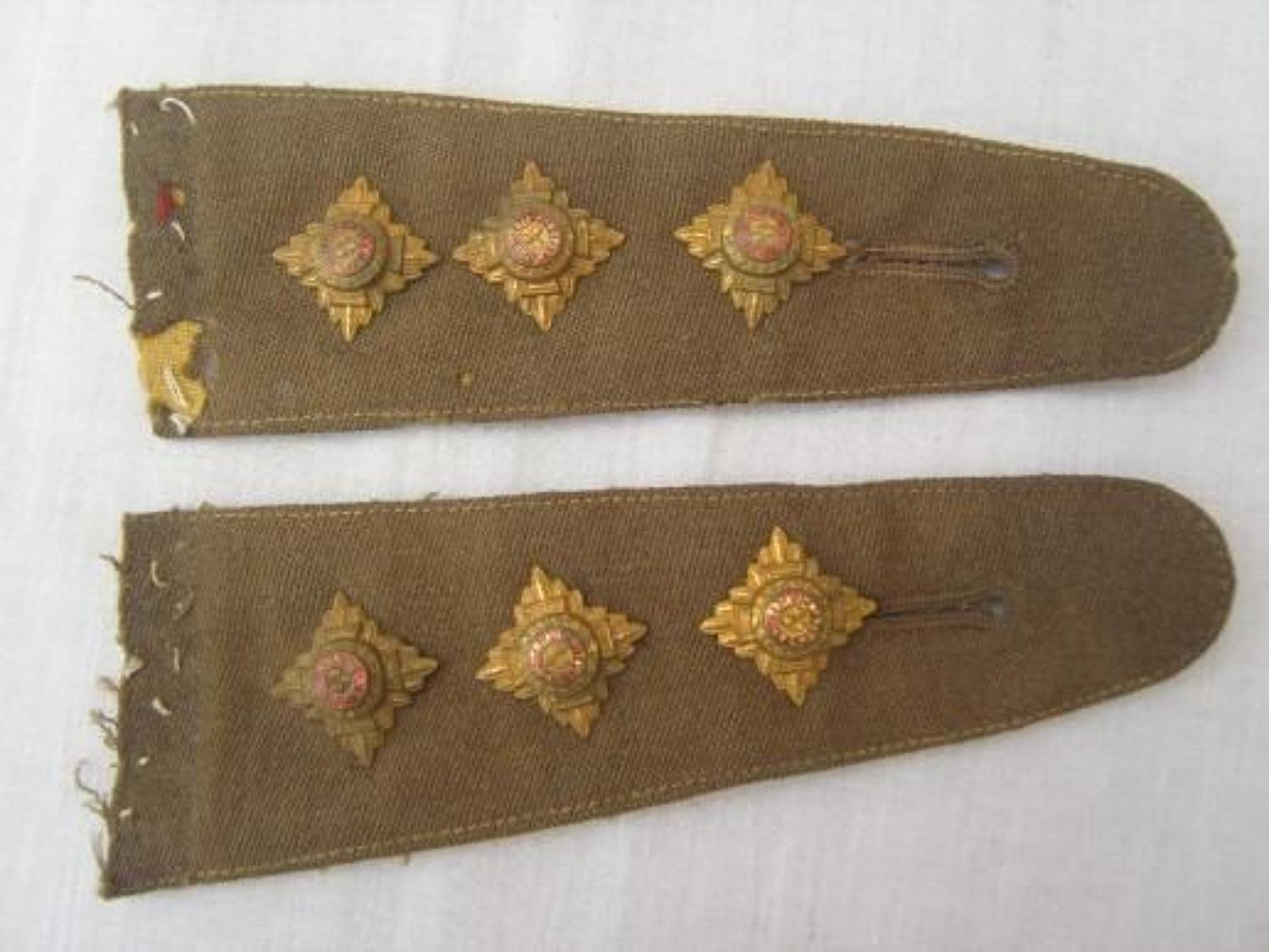 Pair of British Army officers shoulder straps to a captain.