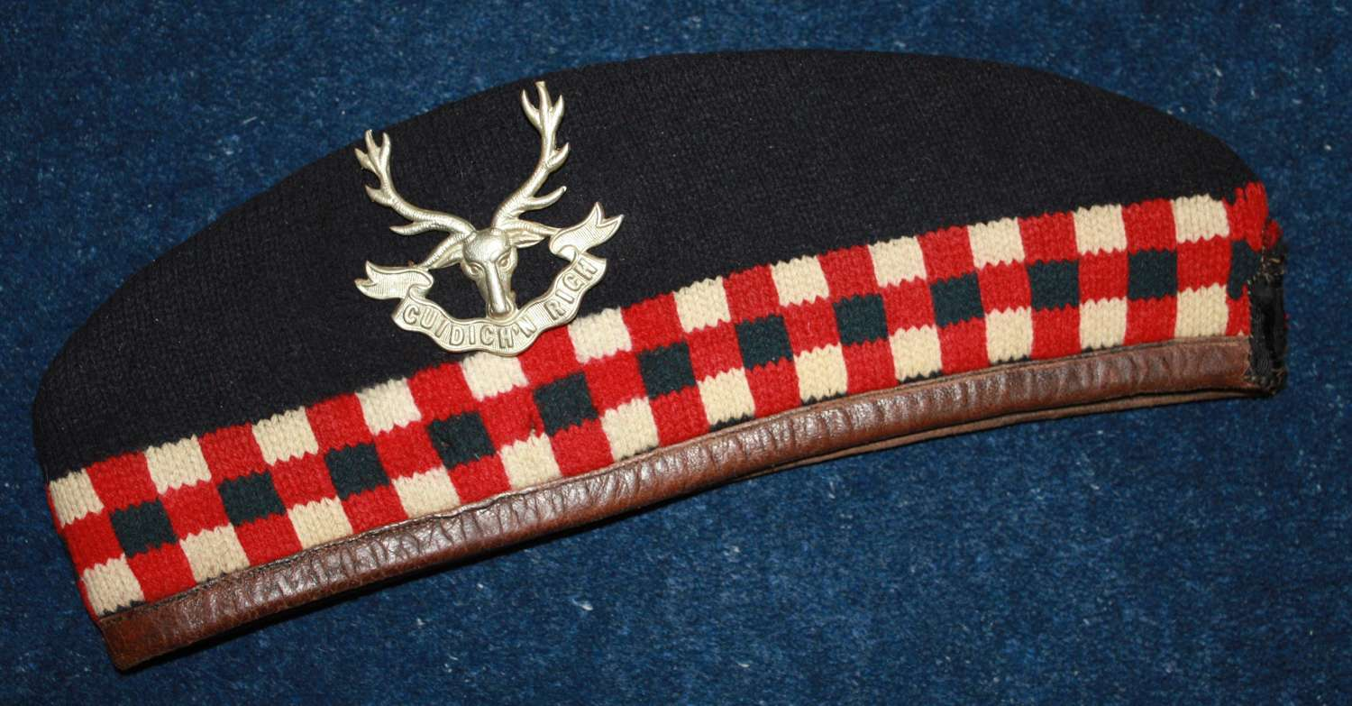 Original WW1 Highland Glengarry with leather trim. Silk tails cut off