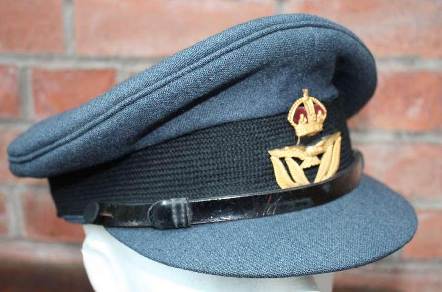 WW2 mint condition RAF Warrant Officers peak cap & Kings Crown Badge.