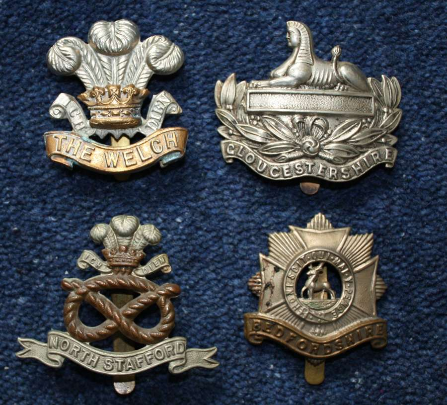 WW1 Four (4) British Army Regimental Cap Badges.