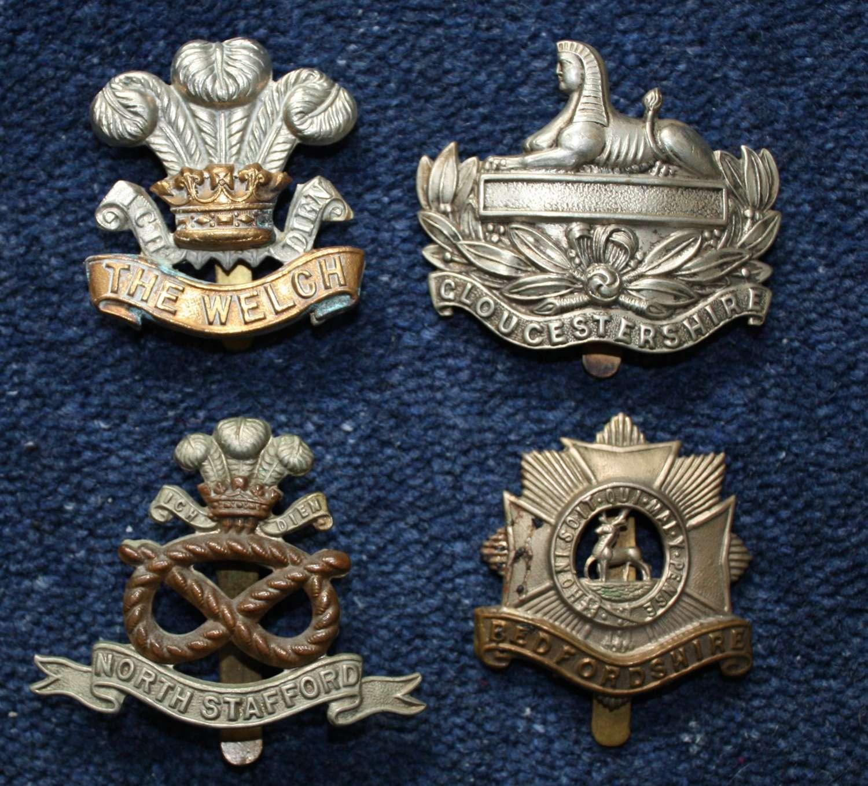 WW1 Four (4) British Army Regimental Cap Badges.