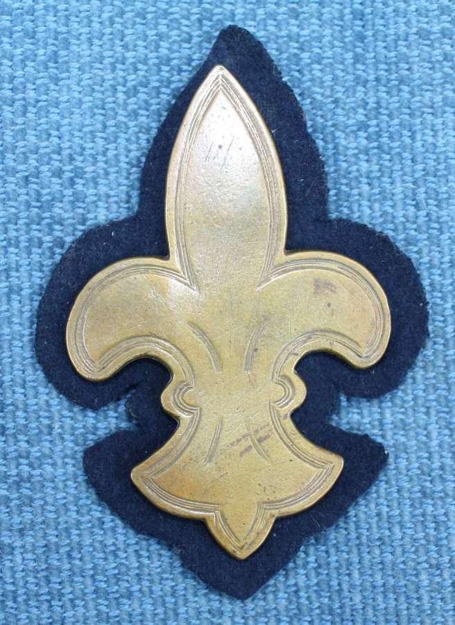 WW1 British Army Cavalry Arm Brass Trade Badge on Blue Felt.