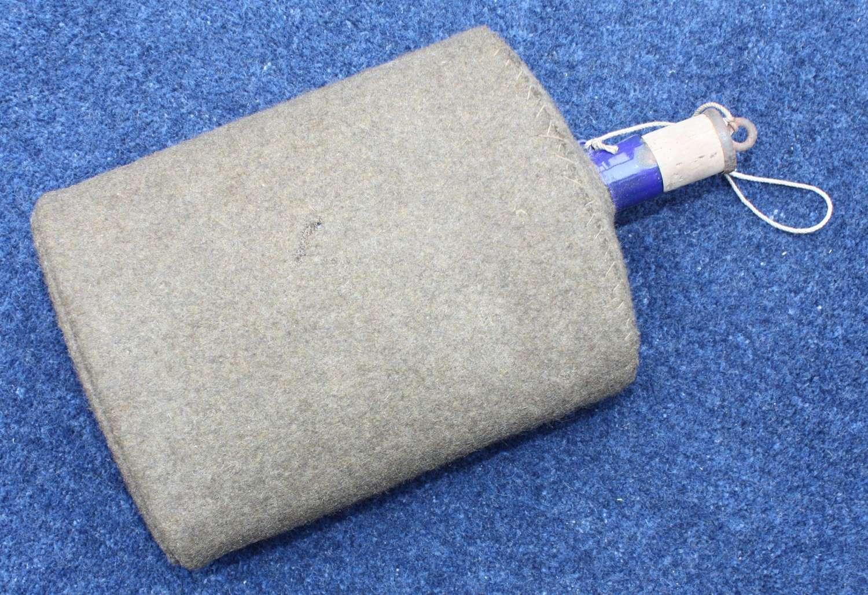 WW1 pattern Mark VII British Army Water Bottle with khaki felt cover.